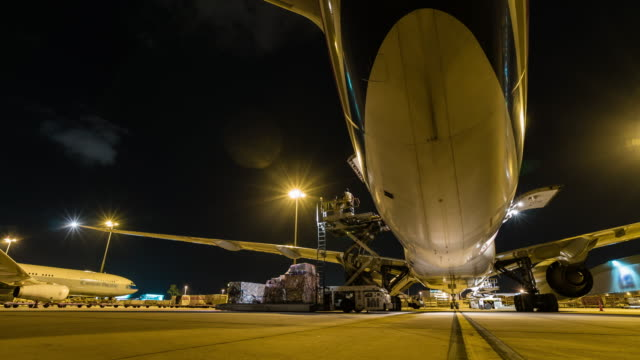 time lapse loading cargo outside cargo plane at night - unloading stock videos & royalty-free footage