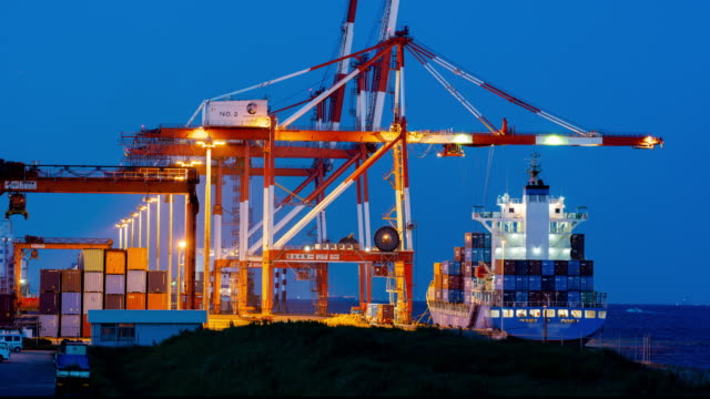 4k time lapse: loading of cargoes on the cargo ship - unloading stock videos & royalty-free footage