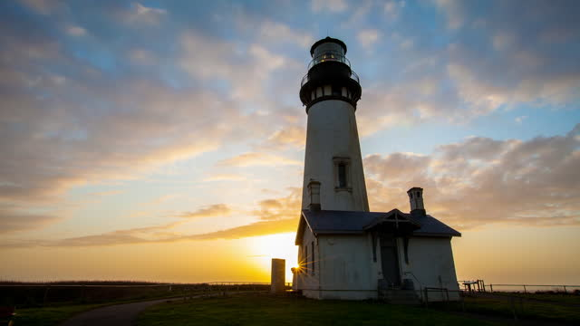 time lapse lockdown shot of clouds moving over lighthouse during sunset - british columbia, canada - fast motion stock videos & royalty-free footage