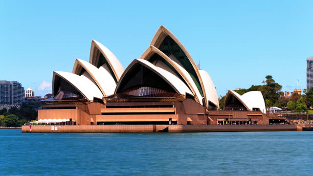 time lapse lockdown: sydney opera house by sea against sky - fast motion stock videos & royalty-free footage