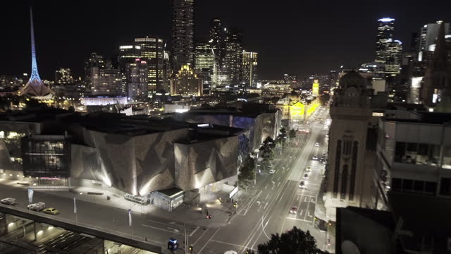 time lapse lockdown: vehicles on street amidst buildings in city - melbourne, australia - fast motion stock videos & royalty-free footage