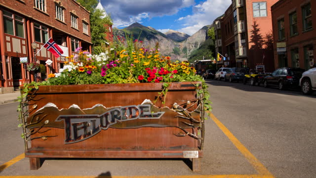 time lapse lockdown wooden container of multi colored flowers on road in town during sunny day - telluride, colorado - wood grain stock videos & royalty-free footage