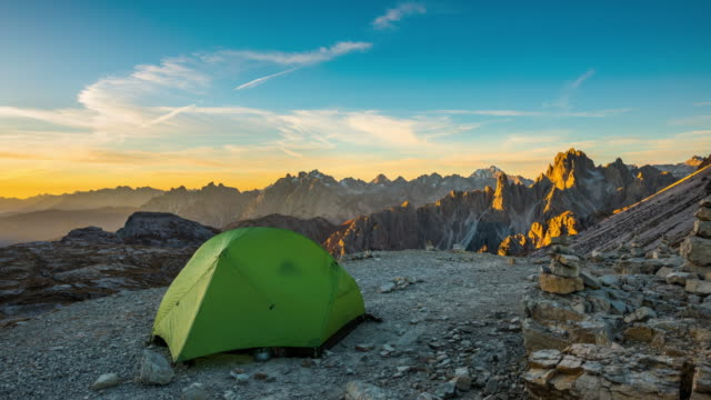 time lapse: lonely tent high up in the mountains - tent stock videos and b-roll footage