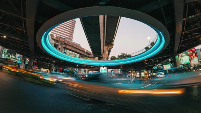 4k time lapse long exposure of traffic jam and car crowd intersection in rush hour at night time in bangkok, transportation with cityscape concept - railroad car stock videos & royalty-free footage