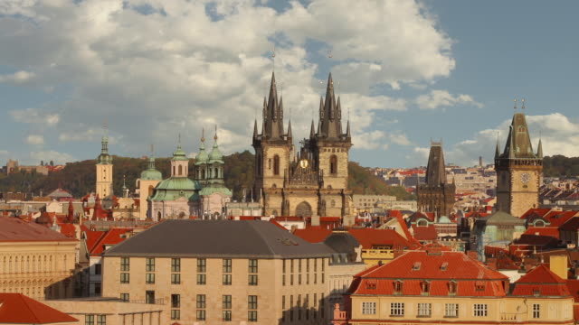 time lapse long shot clouds over spires of church of our lady before tyn, st nicholas church and tower / prague - mala strana stock videos and b-roll footage