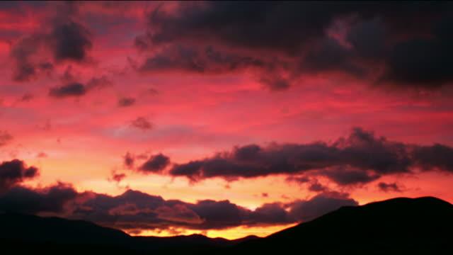 Time lapse long shot sunrise over valley / Craigieburn Range / Canterbury, New Zealand
