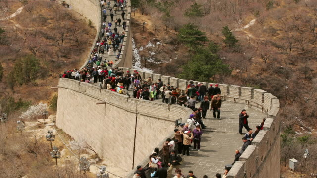 Time lapse low angle long shot tourists climbing and descending the stairs of the Great Wall at Badaling / China