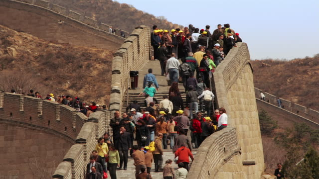 Time lapse low angle medium shot tourists climbing and descending the stairs of the Great Wall at Badaling / China