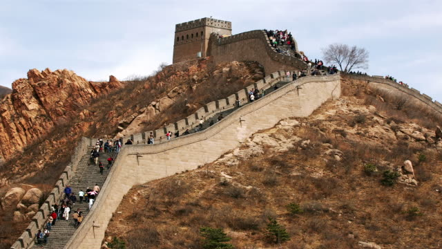 time lapse low angle medium shot tourists climbing and descending the stairs of the great wall at badaling / china - badaling great wall stock videos & royalty-free footage