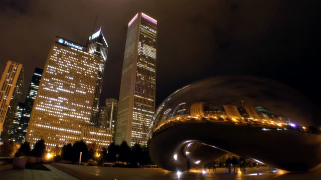 time lapse low angle view clouds and buildings reflected in the cloudgate sculpture in milennium park / night / chicago, illinois - one prudential plaza stock videos & royalty-free footage