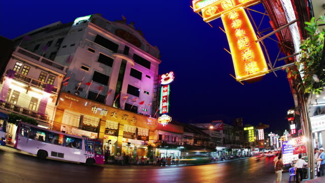 time lapse low angle wide shot traffic and pedestrians on yaowarat road in chinatown / bangkok, thailand - chinatown stock videos and b-roll footage