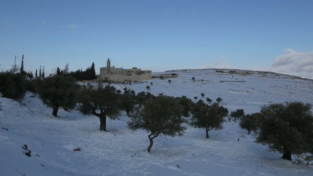 time lapse, mar elias monastery with olive trees in winter snow, jerusalem - monastero video stock e b–roll