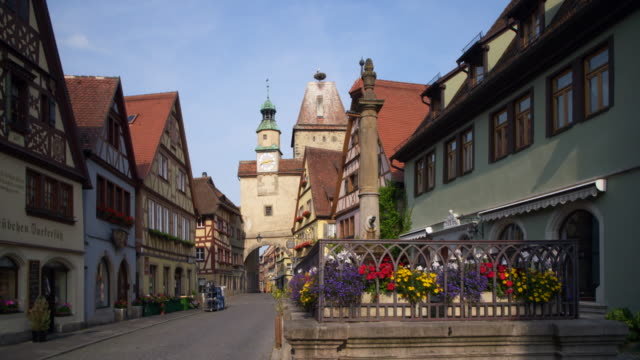 time lapse. markus tower and röder arch (roeder arch). rothenburg ob der tauber, romantic road, franconia, bavaria, germany, europe. - romantic road germany stock videos and b-roll footage