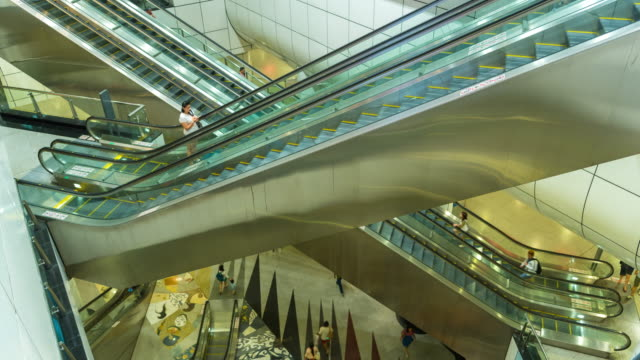4k time lapse : massive of people use escalators in luxury shopping mall - design professional stock videos & royalty-free footage