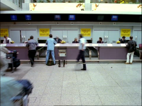 archival time lapse - mcu people at airport check-in desk - 1994 stock videos and b-roll footage