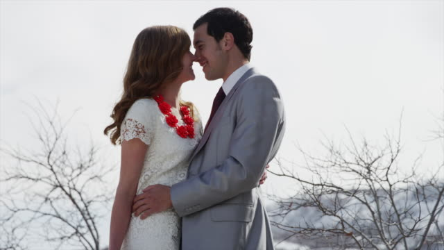 Time lapse medium shot of bride and groom kissing outdoors / Utah, United States,