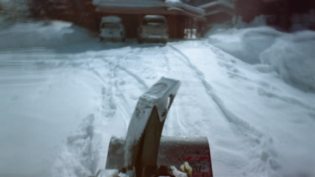 time lapse medium shot snowblower point of view  / man cleaning snow off cars / clearing snow around country house - jackson hole stock-videos und b-roll-filmmaterial