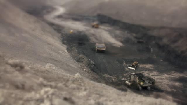 Time Lapse (Tilt-Shift) Mining trucks at a coal mine