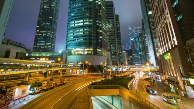 Time lapse Modern building at central district in Hong Kong City skyline at night