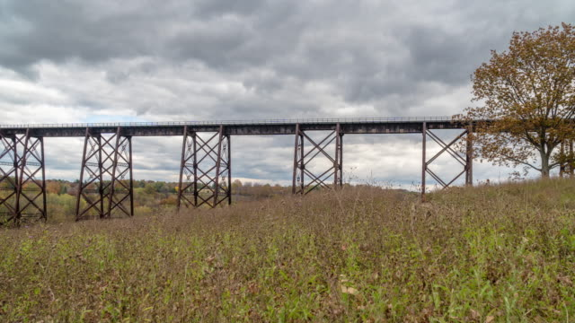 time lapse moodna viaduct, salisbury mills train trestle bridge. autumn, fall leaves colorful hudson valley new york. - hudson valley stock videos and b-roll footage