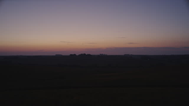 Time lapse Morning-break over rolling hills and cornfields.