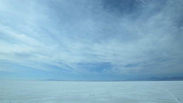 time lapse movie of clouds moving through the vast desert at the utah salt flats - bonneville salt flats stock videos and b-roll footage