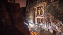Time lapse Movie of Petra by Night, while people lighting candle front of The Treasury (Al-Khazneh), most elaborate temples in the ancient Arab Nabatean Kingdom city of Petra