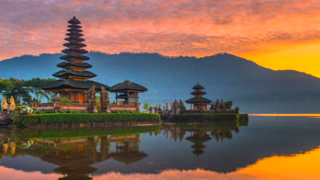 4k time lapse movie sunrise scene of pura ulun danu bratan temple, bali, indonesia - pura ulu danau temple stock videos & royalty-free footage