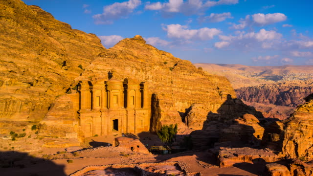 time lapse movie sunset and moving cloud of panoramic scene of the monastery in ancient city of petra, jordan - ancient civilization stock videos & royalty-free footage