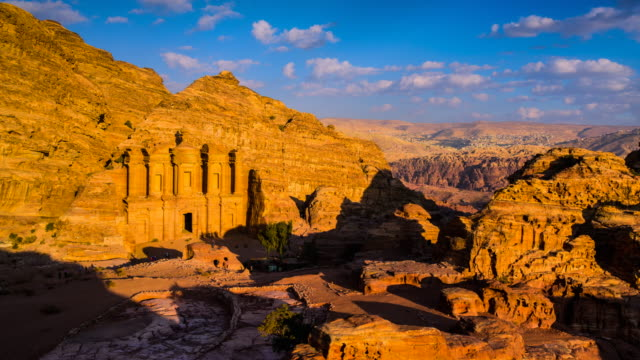 time lapse movie sunset and moving cloud of panoramic scene of the monastery in ancient city of petra, jordan - mountain range stock videos & royalty-free footage