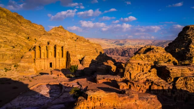 time lapse movie sunset and moving cloud of panoramic scene the tombs of petra, jordan - temple building stock videos & royalty-free footage