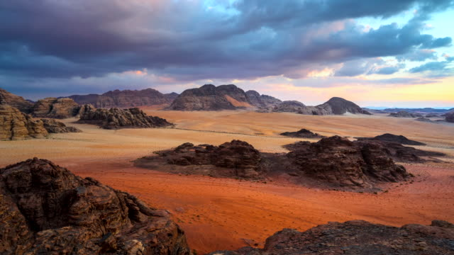 time lapse movie sunset scene of wadi rum desert in jordan, it is also known as the valley of the moon, many movie shot in wadi rum - desert stock videos & royalty-free footage