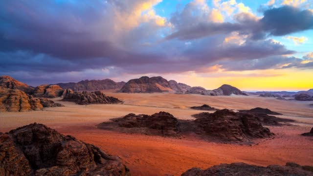 time lapse movie sunset scene of wadi rum desert in jordan, it is also known as the valley of the moon, many movie shot in wadi rum - prehistoric art stock videos & royalty-free footage