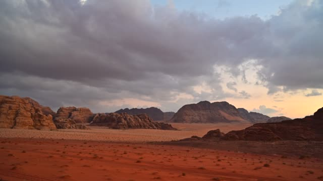 time lapse movie sunset scene of wadi rum desert in jordan, it is also known as the valley of the moon, many movie shot in wadi rum - mineral stock videos & royalty-free footage