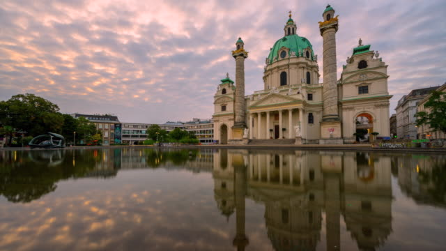 time lapse moving cloud at sunrise scene of karlskirche or st. charles's church in vienna, austria - prater park stock videos & royalty-free footage