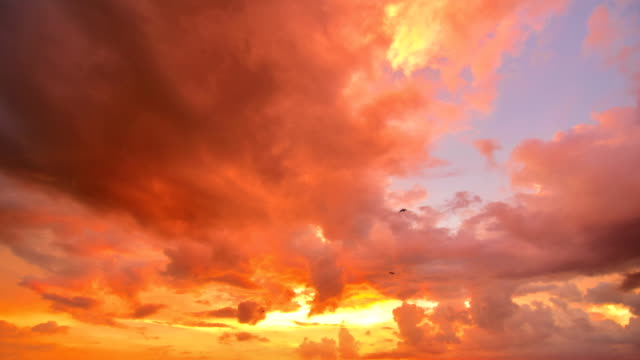 4k time lapse: moving cloud at sunset - sky stock videos & royalty-free footage