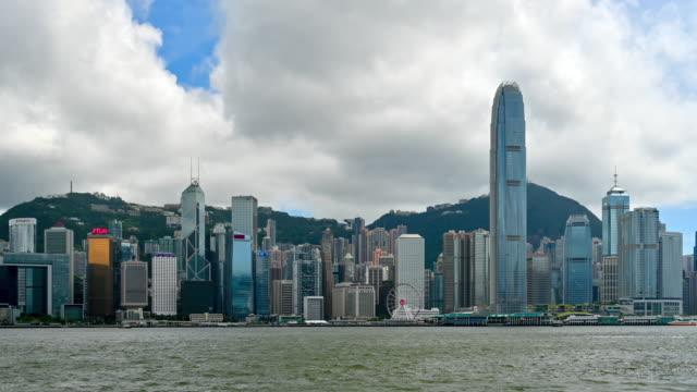 time lapse moving cloud with hong kong skyline at victoria bay, hong kong - central plaza hong kong stock videos and b-roll footage
