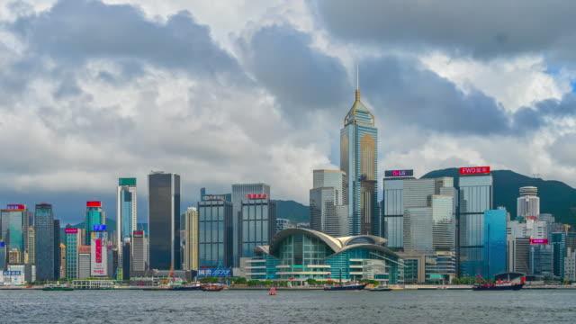 time lapse moving cloud with hong kong skyline at victoria bay, hong kong - central plaza hong kong stock videos & royalty-free footage