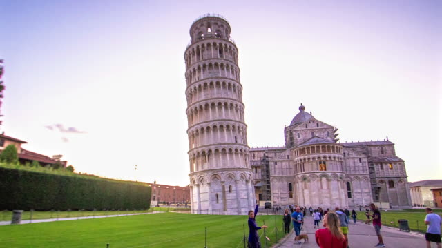 time lapse moving toward leaning tower of pisa on a cloudless day - pisa cathedral stock videos & royalty-free footage
