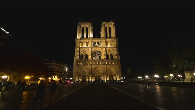 time lapse moving towards notre-dame in paris illuminated at night - notre dame de paris stock videos and b-roll footage