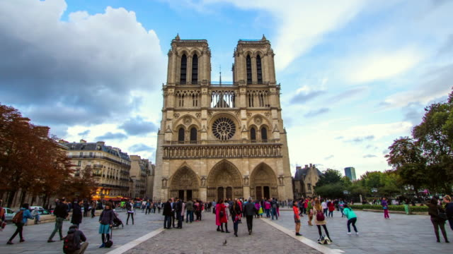 time lapse moving towards notre-dame in paris past many tourists - fast motion time lapse stock videos & royalty-free footage