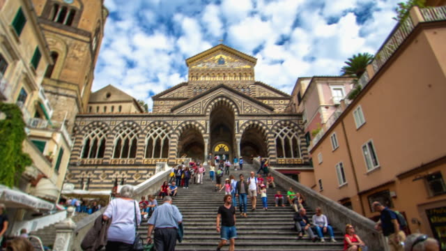 time lapse moving up the steps of amalfi cathedral to the bronze portal - fast motion time lapse stock videos & royalty-free footage