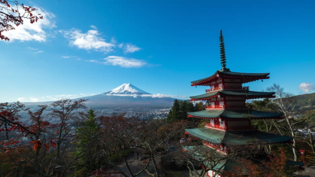 time lapse mt. fuji with red pagoda in autum, fujiyoshida, japan - pagoda stock videos and b-roll footage
