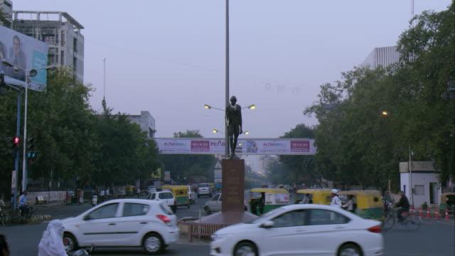 time lapse near gandhi statue in india - mahatma gandhi stock videos & royalty-free footage