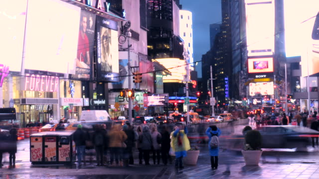 time lapse new york city times square traffic and pedestrians in the rain - yellow taxi stock videos & royalty-free footage