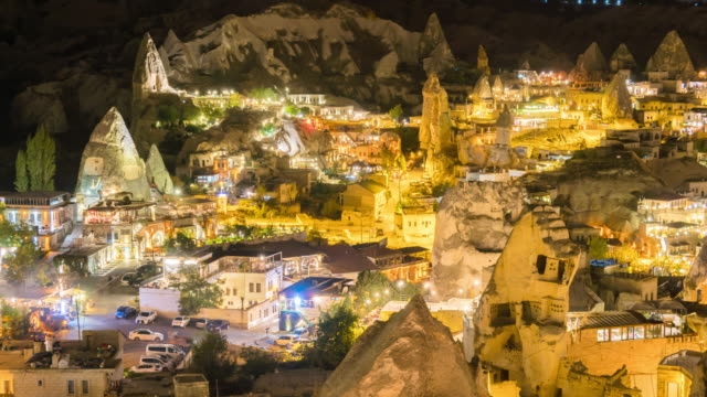 time lapse : night city cappadocia in turkey with ancient cave houses near goreme - cliff dwelling stock videos & royalty-free footage