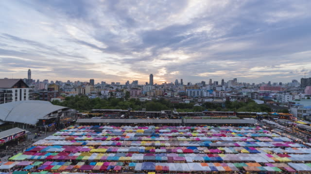 Time lapse Night market at Bangkok-day to night (zoom out)