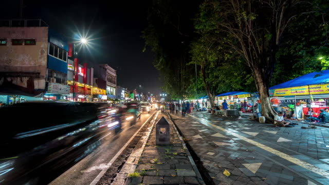 4k time lapse : night market in yogyakarta - jakarta stock videos & royalty-free footage
