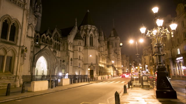 ws time lapse night of fleet street and royal courts of justice - courthouse stock videos & royalty-free footage