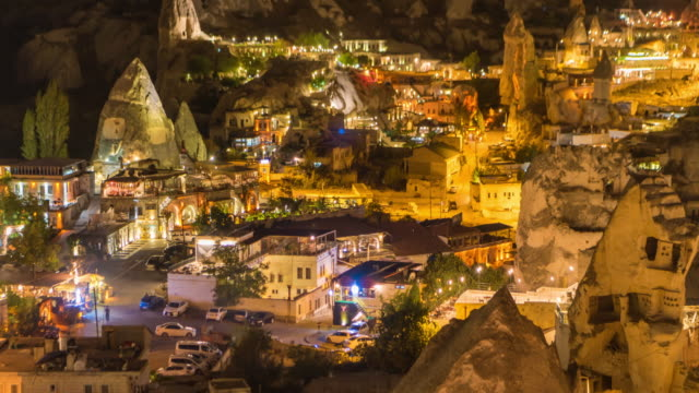 time lapse : night panoramic  ancient cave houses in goreme city, cappadocia, turkey - cliff dwelling stock videos & royalty-free footage